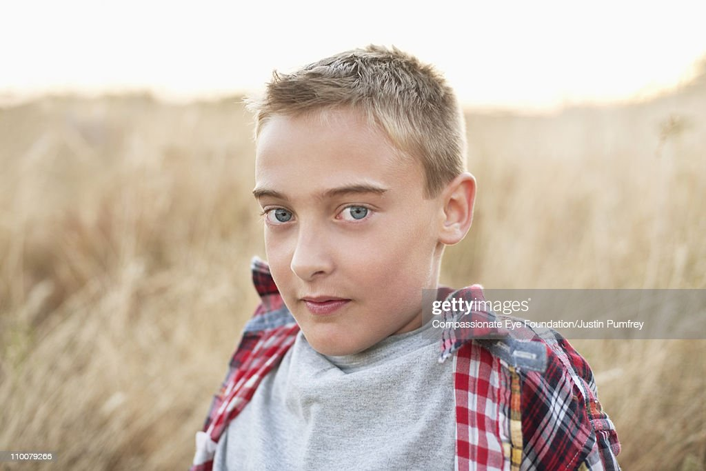 Portrait of boy wearing a plaid shirt : Stock Photo