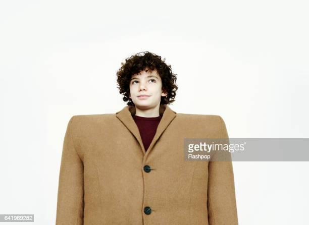 Portrait of boy wearing big coat