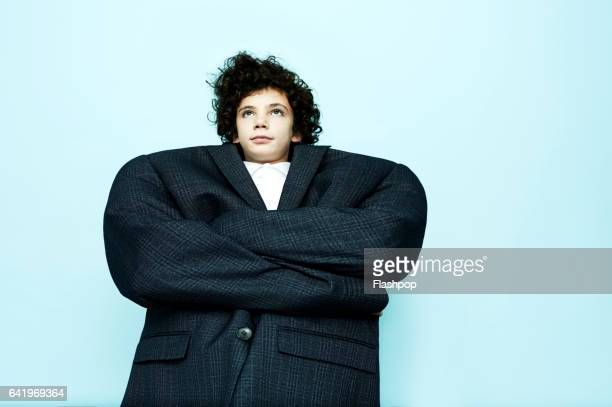 portrait of boy wearing big coat - oversized stock pictures, royalty-free photos & images