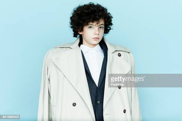 portrait of boy wearing big coat - children only stock pictures, royalty-free photos & images