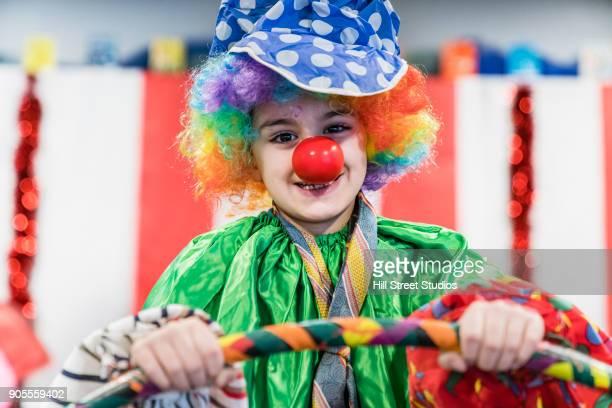 portrait of boy wearing clown costume - ピエロ ストックフォトと画像
