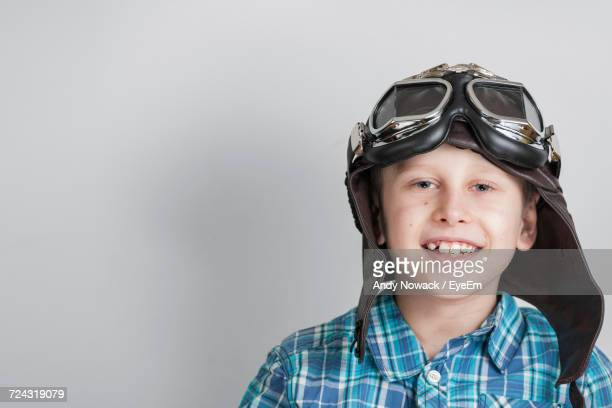 portrait of boy wearing hat against white background - aviator's cap stock pictures, royalty-free photos & images