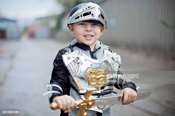 Portrait of boy (7-9) wearing knight costume