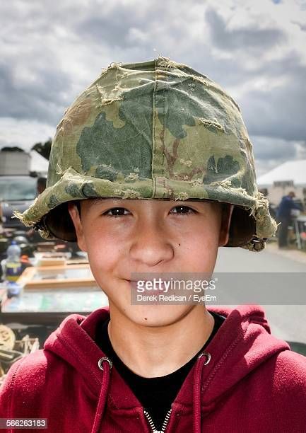 Portrait Of Boy Wearing Marine Helmet