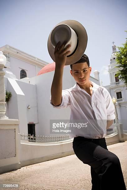 Portrait of boy wearing Plena traditional attire, outdoors