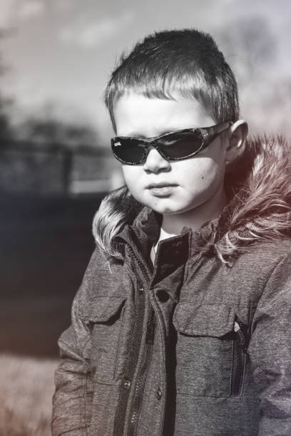 Portrait Of Boy Wearing Sunglasses Standing Outdoors