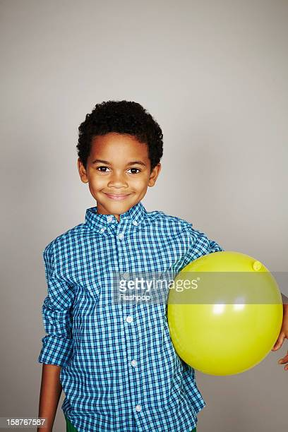 Portrait of boy with balloon