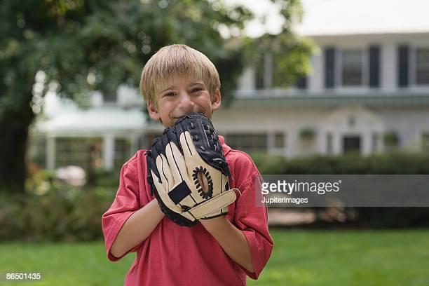 Portrait of boy with baseball glove