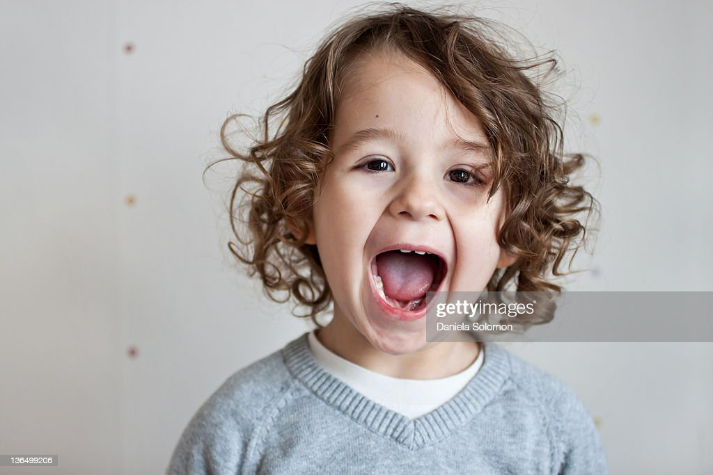 Portrait of boy with curly brown hair : Stock Photo