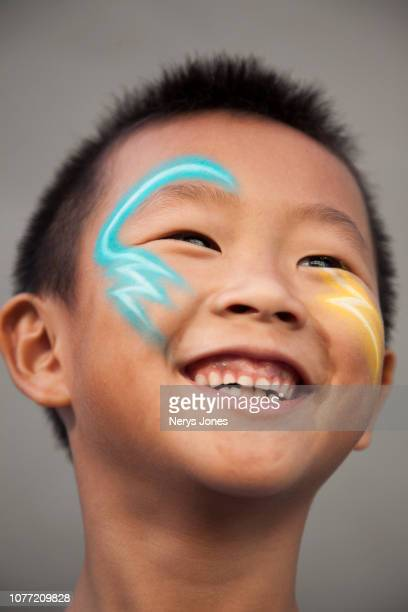 portrait of boy with face paint depicting his chosen super power - nerys jones stock photos and pictures