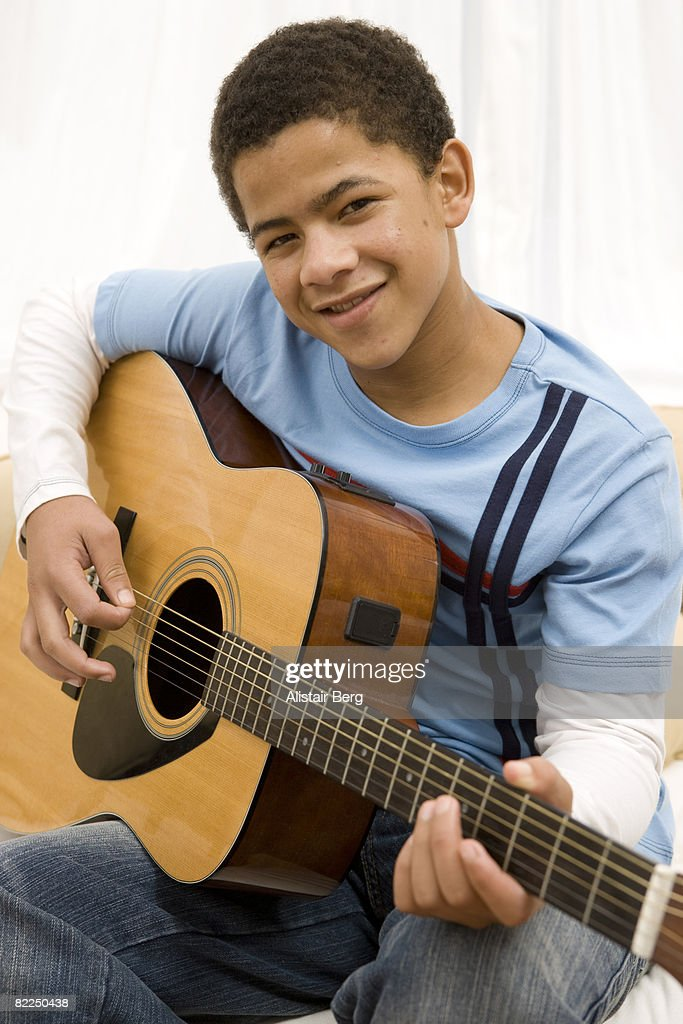 Portrait of boy with guitar : Stock Photo