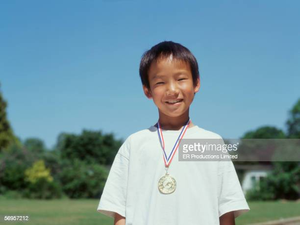 Portrait of boy with medal around neck