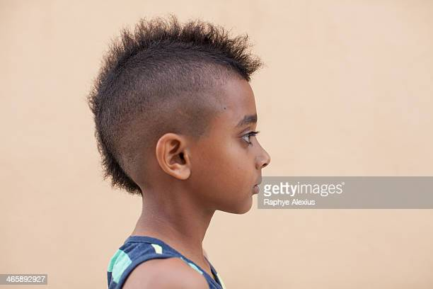 portrait of boy with mohawk hairstyle, side view - shaved head stock pictures, royalty-free photos & images