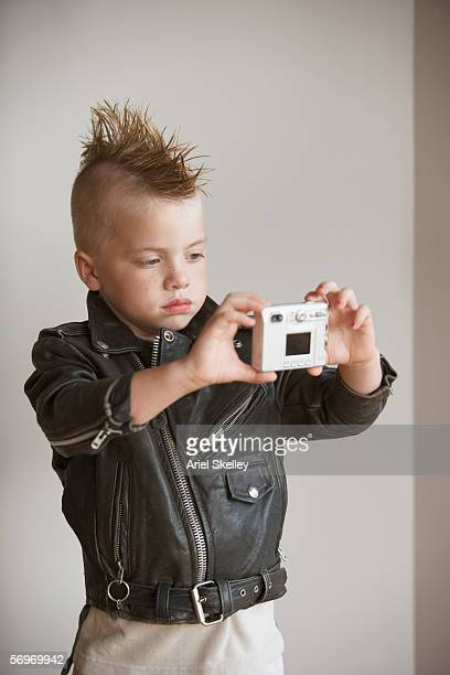 portrait of boy with mohawk in leather jacket taking picture of himself - ariel rebel stock pictures, royalty-free photos & images