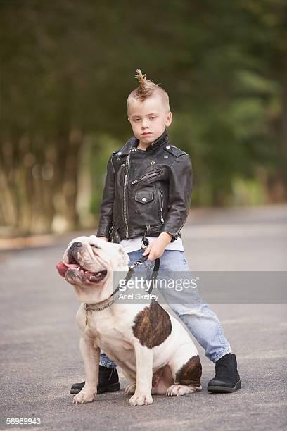 portrait of boy with mohawk in leather jacket with bulldog - ariel rebel fotografías e imágenes de stock
