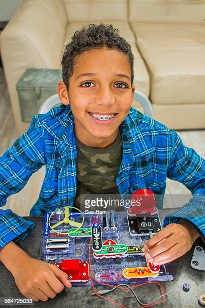Portrait of boy with science project, smiling