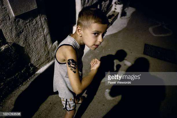 Portrait of boy with tattoo