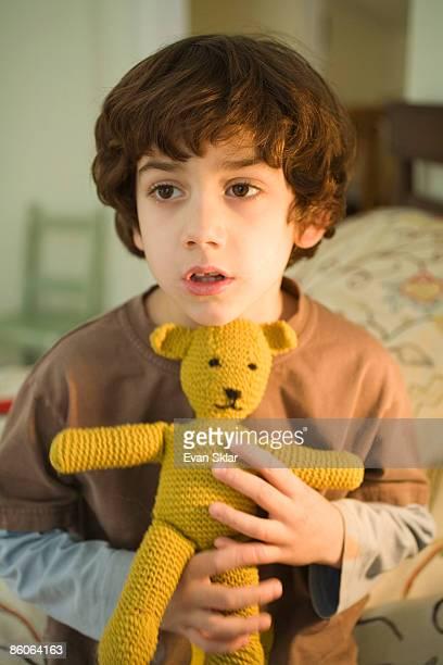 Portrait of boy with teddy bear