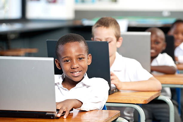 portrait of boy working on laptop computer in classroom johannesburg picture