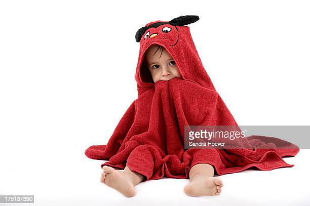 Portrait of boy (2-3) wrapped in red towel