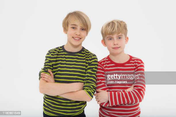 portrait of boys against white background - side by side stock pictures, royalty-free photos & images