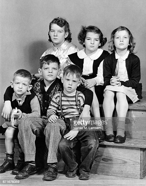 portrait of boys and girls sitting on stairs - {{relatedsearchurl(carousel.phrase)}} imagens e fotografias de stock
