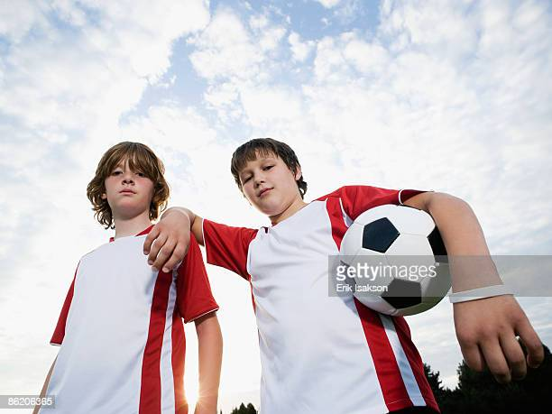 Portrait of boys in soccer uniforms holding ball
