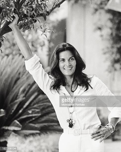 Portrait of Brazilian actress Florinda Bolkan smiling in a garden Taormina 1970s