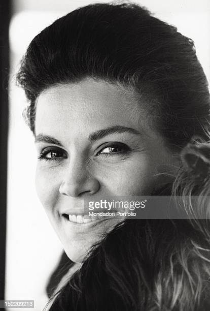 Portrait of Brazilian actress Florinda Bolkan smiling with her Yorkshire Terrier Rooley Venice 1970s