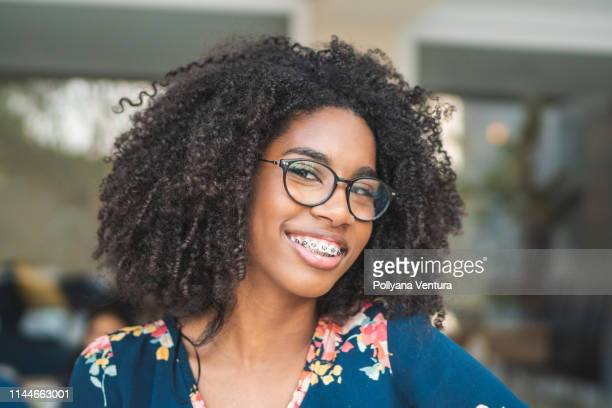 portrait of brazilian afro woman wearing glasses - brace stock pictures, royalty-free photos & images