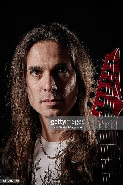 Portrait of Brazilian musician Kiko Loureiro guitarist with thrash metal group Megadeth photographed backstage before a live performance at Wembley...