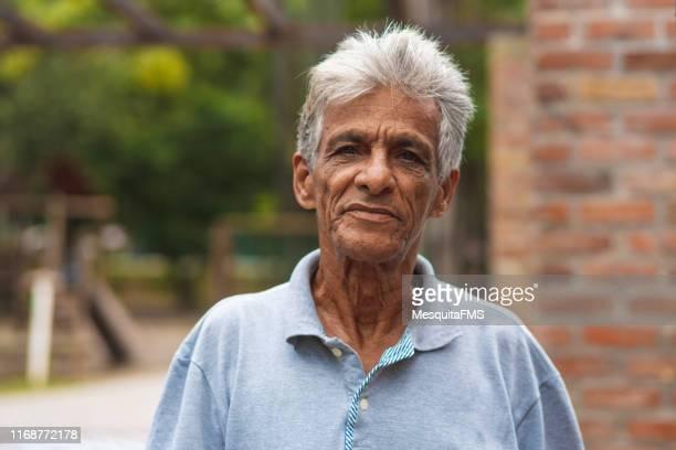 portrait of brazilian senior man - brazilian ethnicity stock pictures, royalty-free photos & images