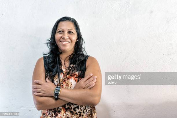 portrait of  brazilian woman in front of white wall