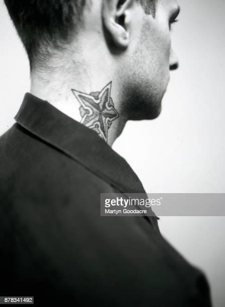 Portrait of Brett Reed of Rancid showing his tattoos Amsterdam Netherlands 1995