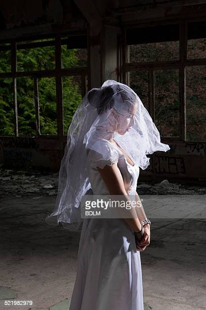 Portrait of bride in empty abandoned interior