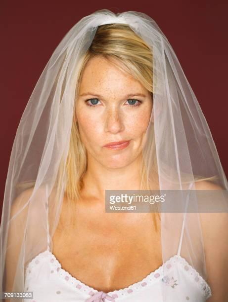portrait of bride pouting - veil stock pictures, royalty-free photos & images