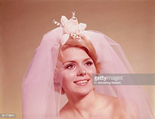 Portrait of bride wearing veil. (Photo by H. Armstrong Roberts/Retrofile/Getty Images)