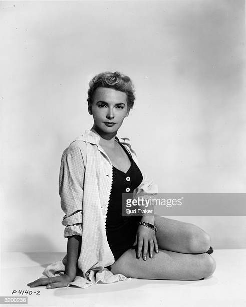A portrait of British actor Elaine Aiken posing in a swimsuit and jacket