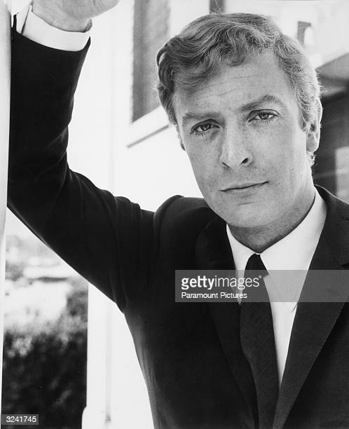 Portrait of British actor Michael Caine leaning on one arm in a still from director Lewis Gilbert's film, 'Alfie'.
