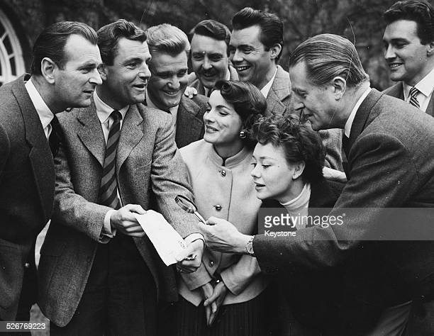 Portrait of British actors posing as detectives following a robbery at Pinewood Studios Nigel Patrick Kenneth More Donald Houston Donald Sinden...