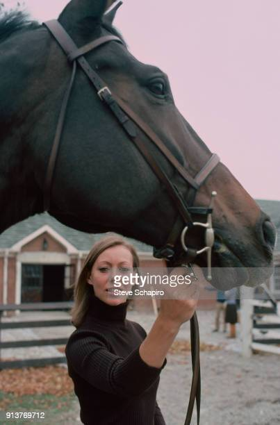 Portrait of British actress Jenny Agutter as she poses with a horse on the set of the film 'Equus' , London, England, 1976.
