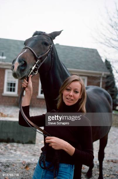 Portrait of British actress Jenny Agutter as she poses with a horse on the set of the film 'Equus' London England 1976