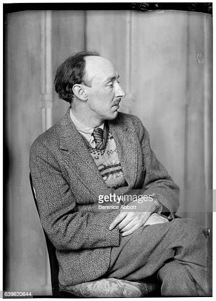 Portrait of British artist Frank Dobson as he sits crosslegged on a chair 1920s