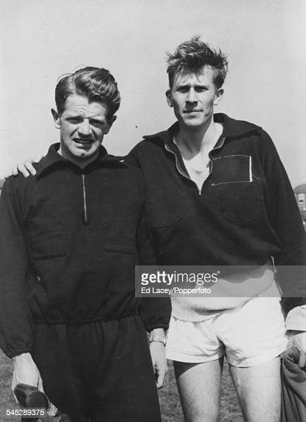 Portrait of British athletes Roger Bannister and Christopher Chataway standing together at an Amateur Athletics Association meet at Iffley Road Track...