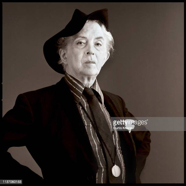 Portrait of British author and actor Quentin Crisp as he poses with his hands on hips, New York, 1980s.