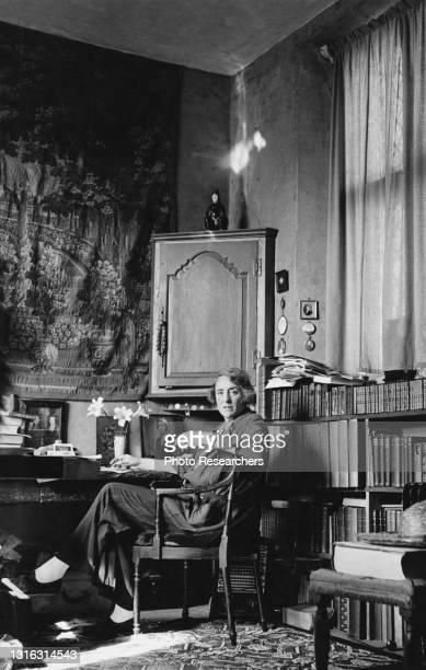 Portrait of British author and gardener Vita Sackville-West, Lady Nicolson as she poses in her study at Sissinghurst Castle Garden, Kent, England,...