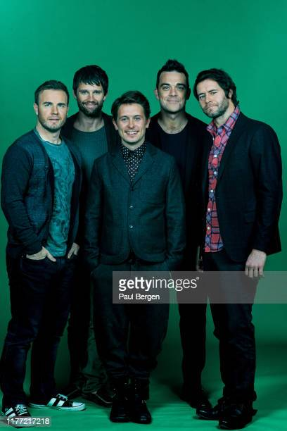 Portrait of British boyband Take That, Amsterdam, Netherlands, 26th November 2011. Left to right Gary Barlow, Jason Orange, Mark Owen, Robbie...