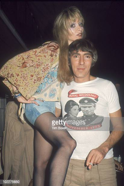 Portrait of British comedian Peter Cook and his wife actress Judy Huxtable at a restaurant as they celebrate the opening night of the stage...