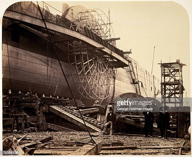 Portrait of British engineer Isambard Kingdom Brunel and several other unidentified men at John Scott Russell's shipyard during the construction of...