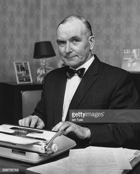 Portrait of British executioner Albert Pierrepoint writing his memoirs 1973